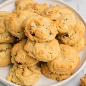 Overhead photo of cranberry white chocolate chip cookies that were made in the air fryer and served on a white plate.