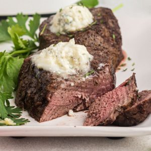 Juicy filet mignon topped with blue cheese butter