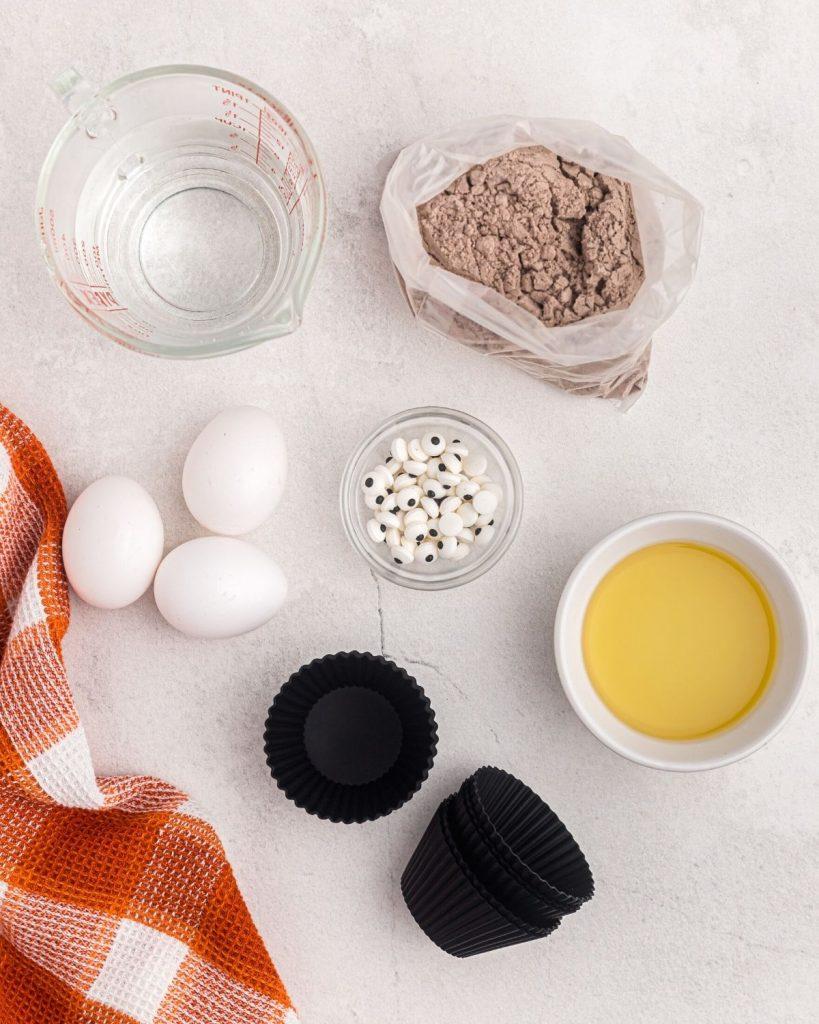Ingredients needed to make air fryer halloween ghost cupcakes.