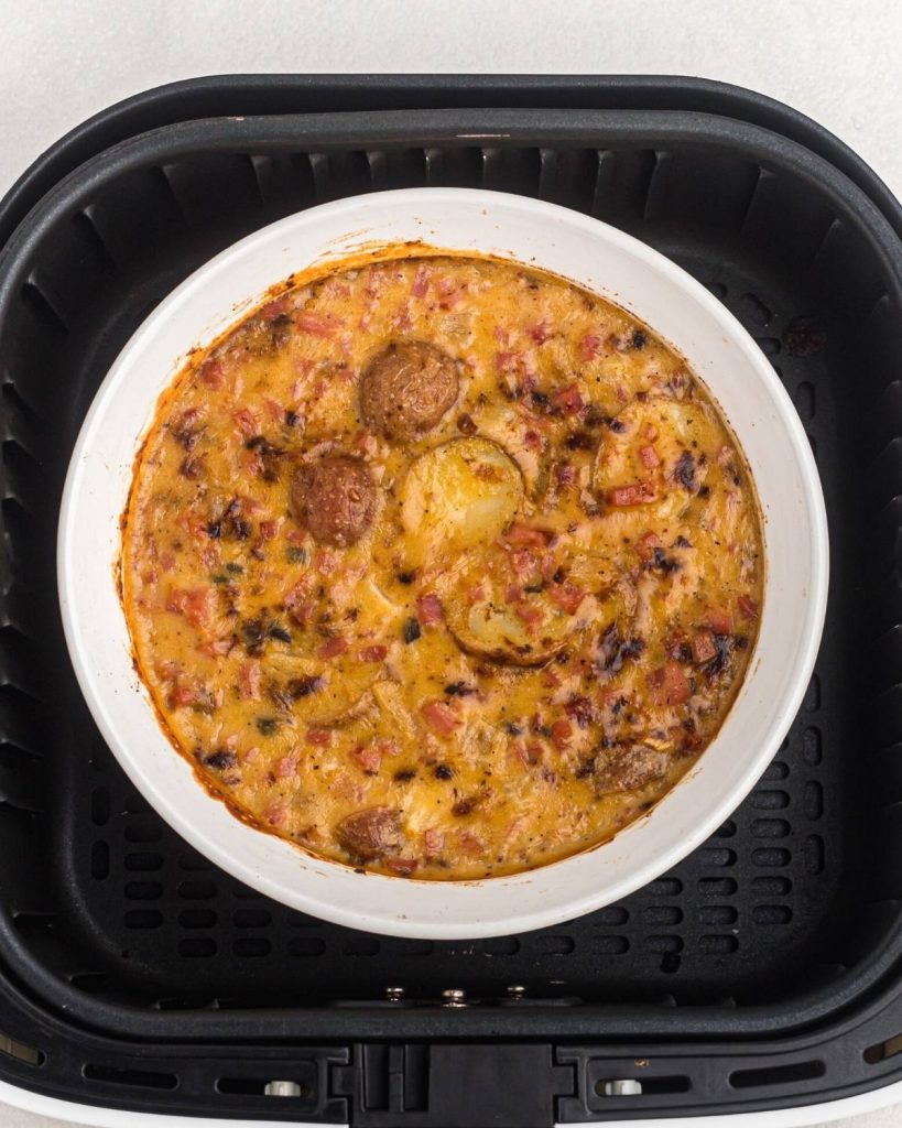 Casserole after being cooked in the air fryer basket.