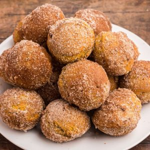Golden donut holes covered in sugar and pumpkin spice